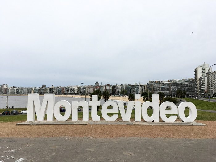Sign written Montevideo with city skyline on the foreground
