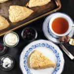 Overhead image of scone and tea